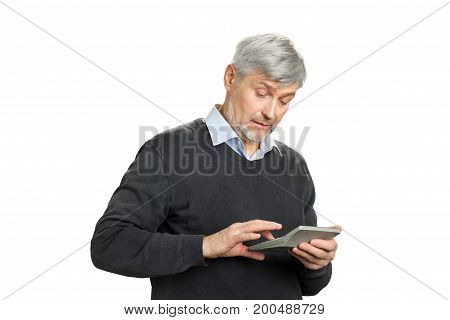 Grey hair man working on calculator. Mature man calculating finance on white background close up.