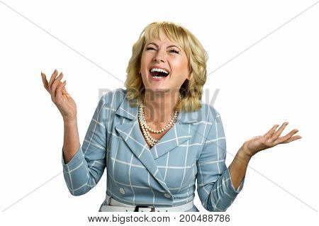 Smiling mature woman raised hands. Excited adult woman laughing with raised hands on white background.