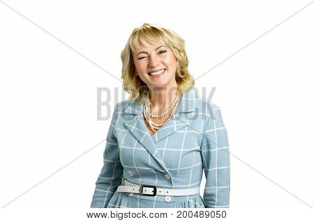 Mature lady twinkling on white background. Portrait of middle aged woman in high spirit twinkling isolated on white background.
