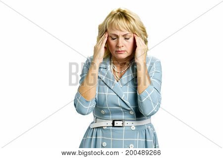 Middle aged woman with terrible headache. Depressed mature women touching her cheekbone and keeping eyes closed feeling migraine on white background.