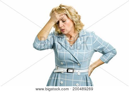 Sick white-skin woman with stong headache. Mature woman having headache touching her forehead on white background close up.