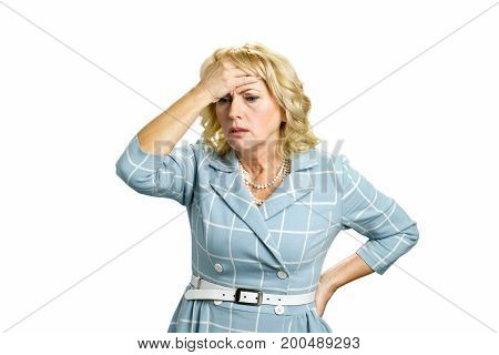 Worried mature woman touching head. Depressed white-skin businesswoman touching her face on white background. Stressed busineswoman with headache, migraine or forgetfulness.