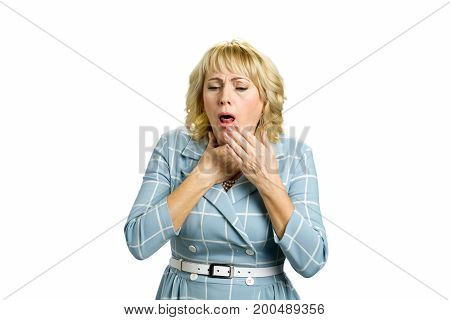 Mature woman suffering from couging. Middle aged woman in bad condition coughing and having flu isolated on white background.