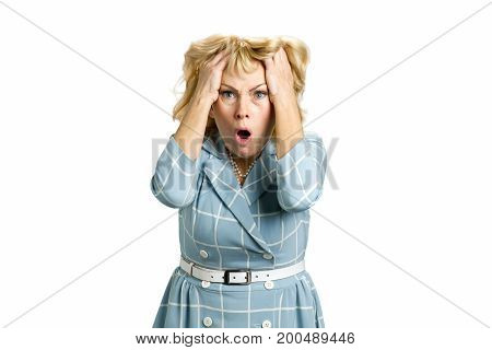 Worried beautiful middle aged woman. Mature woman looking shocked and horrified on white background. Portrait of stunned white-skin woman on white background.