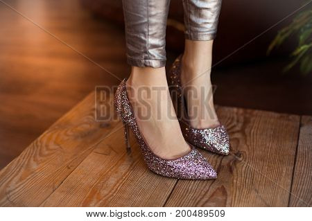 Beautiful High-heeled Glitter Shoes. Beautiful Unusual Shoes Wearing On Legs Of Slim Young Woman.