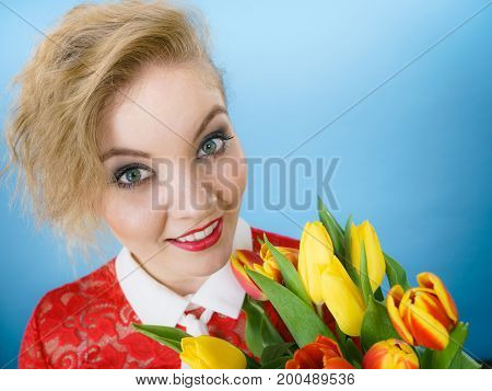 Woman Holding Bouquet Of Tulips Flowers