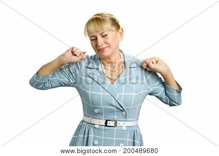 Stretching sleepy mature woman. Beautiful tired fatigued woman stretching extending arms, back, shoulders isolated on white background.