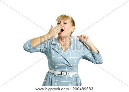 Yawning woman on white background. Beautiful stretching and yawning white-skin woman isolated on white background.
