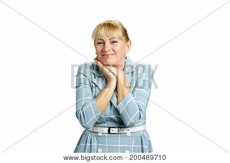 Portrait of cheerful mature woman. Adult woman clasped her hands under chin isolated on white background.