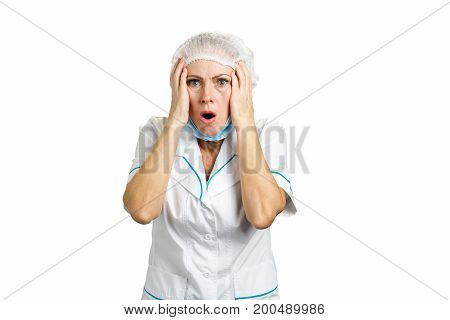 Attractive female doctor looking shocked. Medical middle aged female doctor shocked and surprised. Woman medical professional reacting with negative shock on white background.
