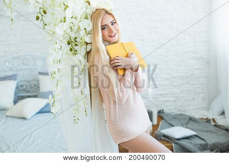 Beautiful And Attractive Blonde Clever Woman Read A Book. Sexy Blonde Young Girl Reading An Interest