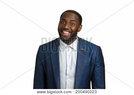 Afro american businessman looking happy. Young successful handsome afro american man in suit smiling. Corporate executive black man with smile.