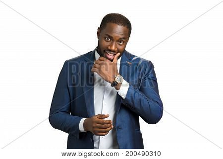 Smart black businessman on white background. Afro american business owner smiling and looking straight. Happy black businessman with cunning look.