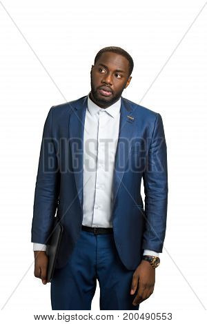 Handsome black businessman with folder. Thoughtful black manager standing on white background. Young executive concentrating on some idea.