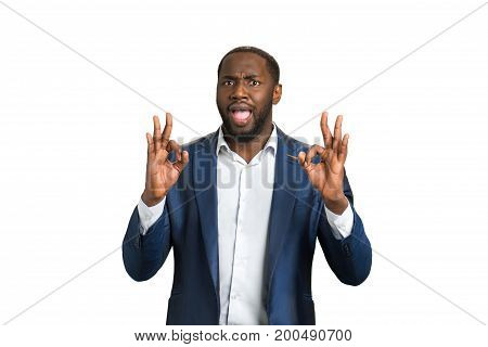 Happy businessman approving good job. Ok hand gesture of cheerful businessman. Business success concept.