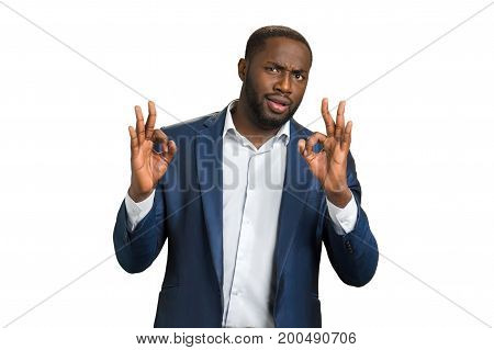 Businessman with gesture everything is ok. Confident young manager with gesture ok. Man in formal wear showing ok hand sign.