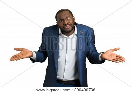 Confused businessman on white background. Unsure afro american manager giving I don t know gesture.