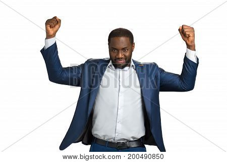 Confident businessman with raised fists. Cheerful young black manager with raised fists. Happy black businessman with spirit expression.