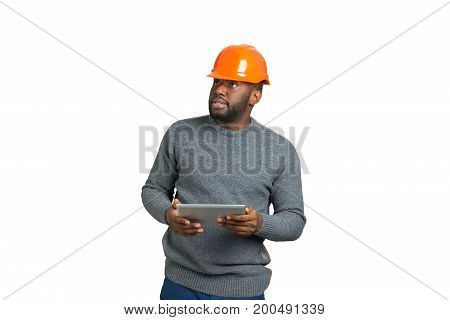 Serious architect holding computer tablet. Young engineer holding touch screen tablet on white background.