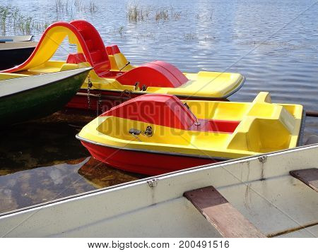 Boats and paddle boats in the shallow water