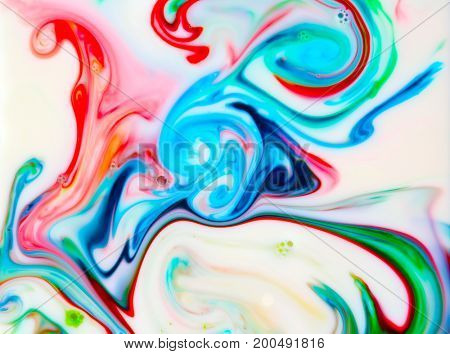 Abstract colorful Backgrounds and textures. Food Coloring in milk. Food coloring in whole milk creating bright colorful abstract backgrounds. Colorful chemical experiment.