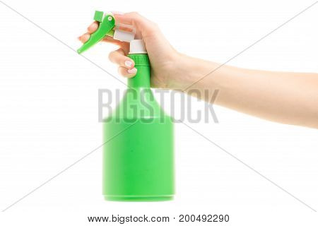 Atomizer in a female hand on a white background isolation
