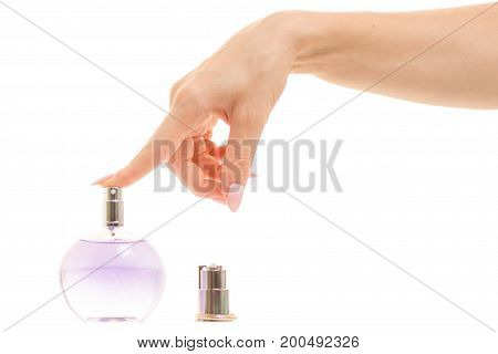 Hand of a woman on perfume on a white background isolation