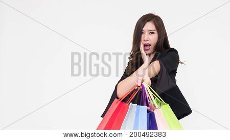 Portrait of young asian woman happy smiling with shopping bags