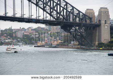 SYDNEY,NSW,AUSTRALIA-NOVEMBER 19,2016: Nautical vessels, Luna Park and Sydney Harbour Bridge with waterfront architecture in Sydney, Australia.