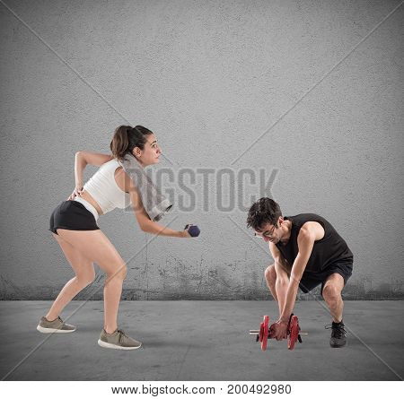 Boy and girl having some difficulty at the gym