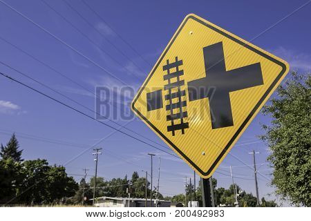 Railroad crossing sign that is diamond shaped