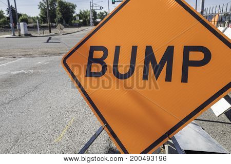 Orange bump sign for a construction zone