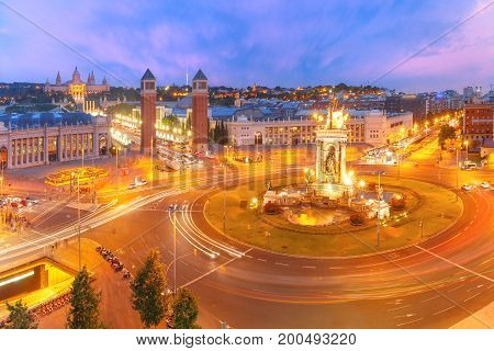 Aerial View on Placa Espanya and Montjuic Hill with National Art Museum of Catalonia in Barcelona at sunset, Catalonia, Spain