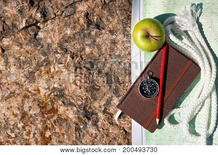 Notebook, Compass, Apple, Rope On Stone Background