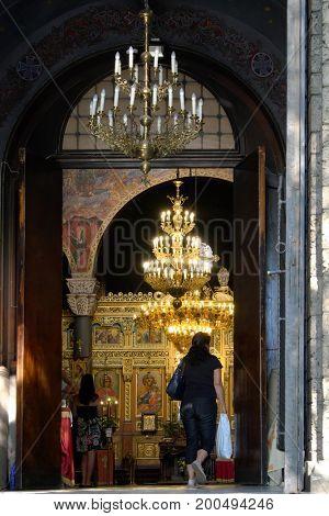 SOFIA, BULGARIA - JULY 31, 2017: Faithful inside of the Saint Nedelya Church in the city center of Sofia