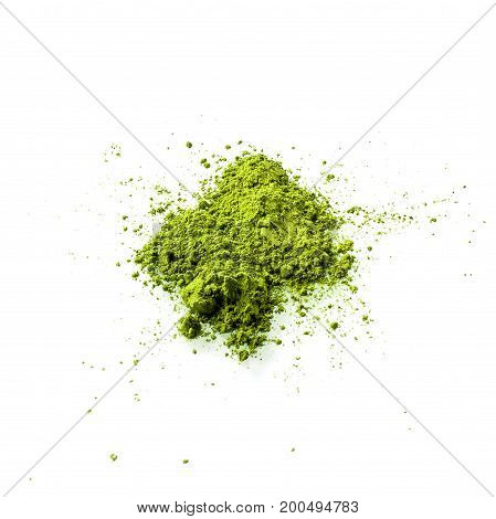 Matcha green tea powder on white background. Matcha is made of finely ground green tea powder. It's very common in japanese culture. Matcha is healthy due to it's high antioxydant count.