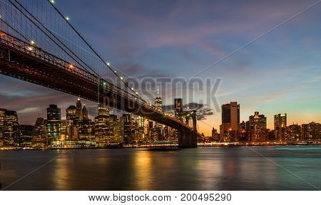 Evening view of Brooklyn Bridge New York at sunset.