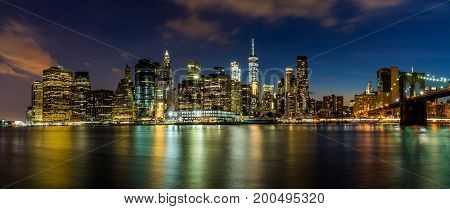 Evening view of Downtown Manhattan from Brooklyn Bridge Dumbo area