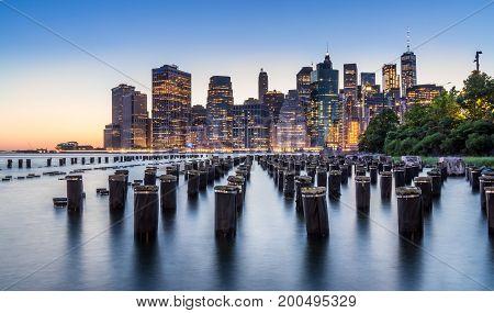Illuminated Downtown Manhattan view from Brooklyn Bridge Park