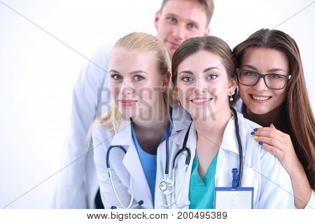 Portrait of group of smiling hospital colleagues standing together . Doctors.