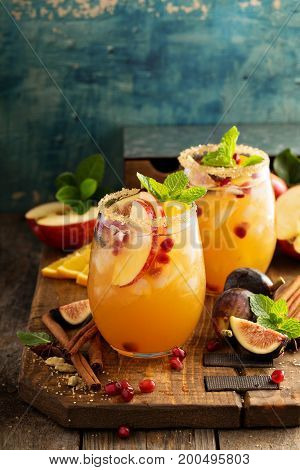 Fall sangria cocktail with spices, apple, figs and orange