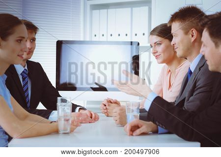 Business people shaking hands after meeting in office
