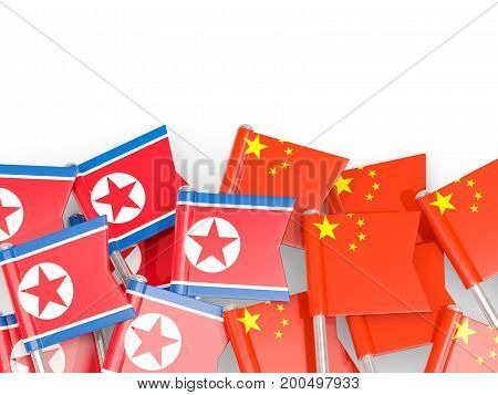 Flag Pins Of North Korea (dprk) And China Isolated On White