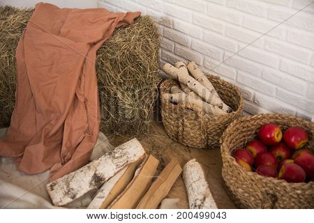 Hay And Birch Firewood, A Basket Of Apples Indoors