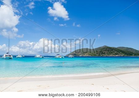 blue sky blue teal water horizon sea landscape with sailboats