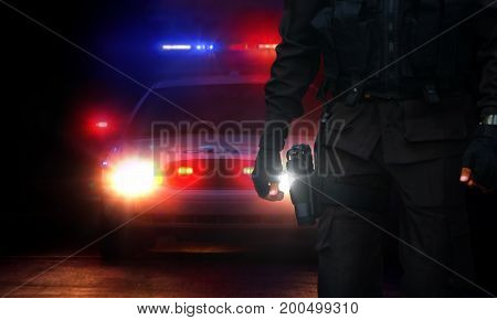 Policeman and patrol car with siren lights on