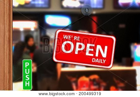 We are open daily sign on shop glass door
