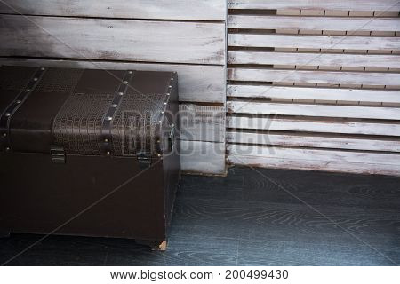 Leather Old Chest Standing On The Floor Against