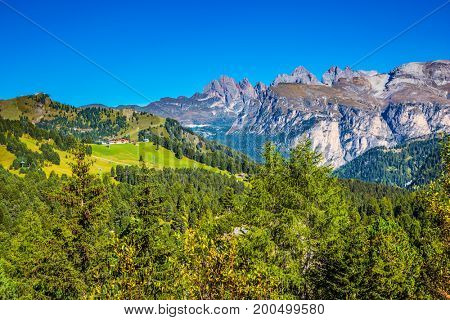 Travel to South Tirol, the Dolomites. The concept of extreme and ecological tourism. Windy autumn day. Wooded plateau on the Sella Pass