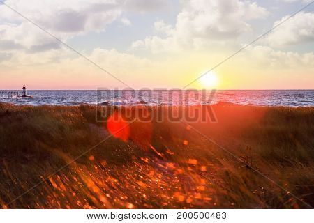 Sunset over the lake with red glowing flares of light